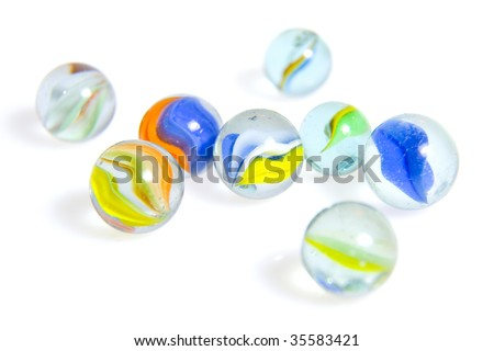 Eight colorful Glasmurmeln with shadow on white background