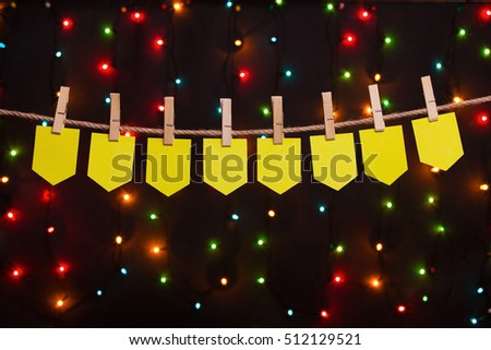 eight festive flags on the background of colored lights