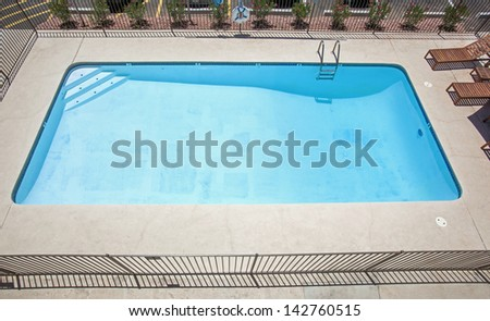 Eight Foot deep swimming pool with steps and ladder - stock photo