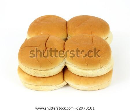 Eight freshly baked hamburger buns on a white background. - stock photo