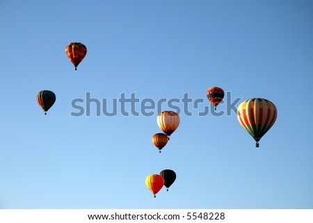 Eight hot air balloons during early morning ascend - stock photo