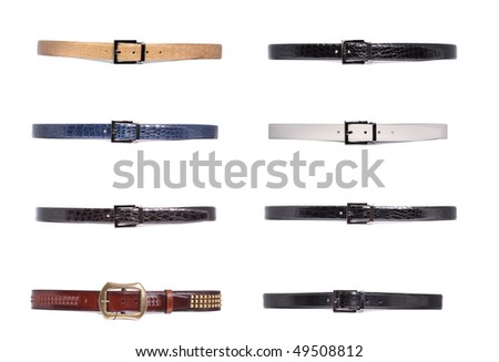 eight leather belts isolated on white background - stock photo