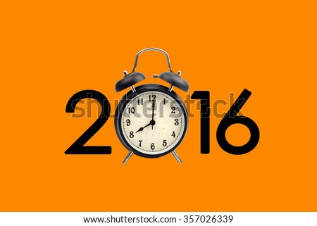 Eight o'clock on a round alarm clock and show year 2016 on orange background - stock photo
