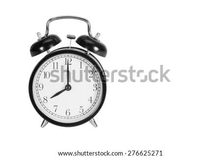 Eight O' Clock on alarm clock isolated on white - stock photo