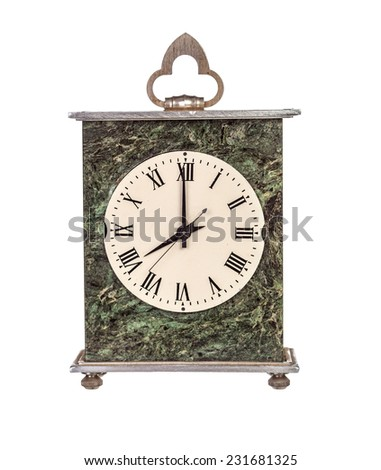 Eight o'clock on mantel clock isolated on white background