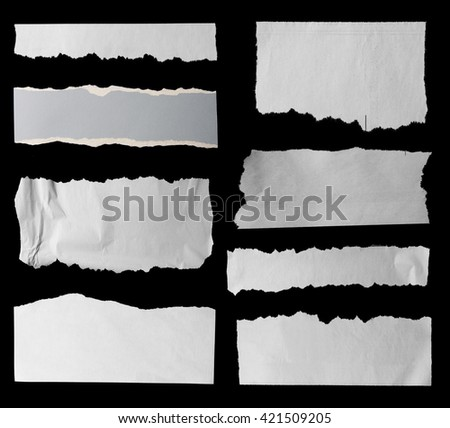 Eight pieces of torn paper on black. Copy space - stock photo