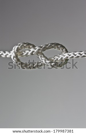 eight rope knot isolated on grey background