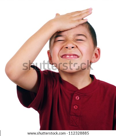 Eight-year-old boy slaps his forehead in an oh-no moment, disappointed, isolated on white background