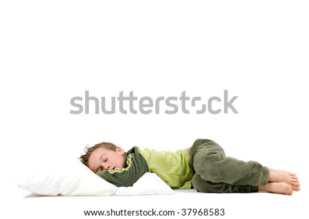 Eight year old boy sleeping and dreaming, isolated on white. - stock photo