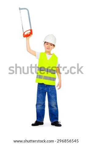 Eight years old boy in a costume of a builder posing with a saw. Isolated over white. Full length portrait. - stock photo