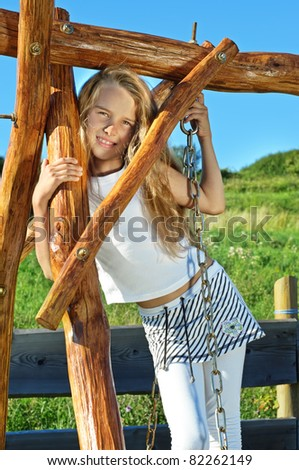 Eight years old long hair girl posing outdoors
