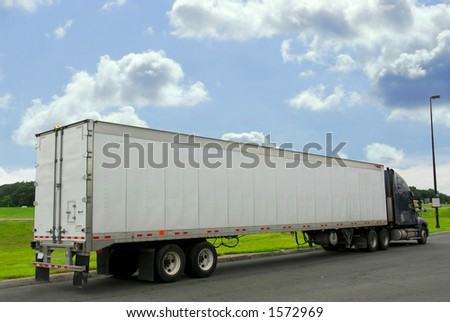Eighteen wheeler truck on a truck stop - stock photo