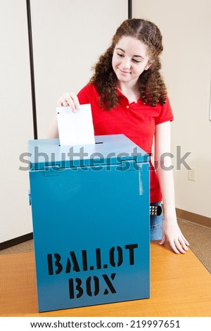 Eighteen year old Latina girl voting for the first time.   - stock photo