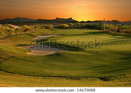 Eighteenth hole on a golf course located in Tucson Arizona at sunset.