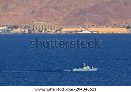 EILAT, ISR - APRIL 15 2015:Israeli Navy boat patrolling in the Gulf of Eilat, Israel.Israel Defense Forces, operating primarily in the Mediterranean Sea theater as well as the Red Sea theater. - stock photo