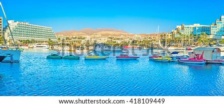 EILAT, ISRAEL - FEBRUARY 23, 2016: Panorama of marina with a lot of tiny colorfull tourist boats, on February 23 in Eilat.