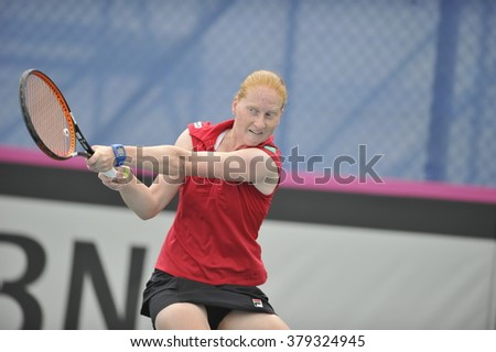 EILAT, ISRAEL - FEBRUARY 05, 2016: Professional tennis player Alison Van Uytvanck from Belgium national team in action during the BNP Paribas FedCup game 2016 at Eilat Tennis Center in Israel