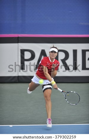 EILAT, ISRAEL - FEBRUARY 05, 2016: Professional tennis player Elitsa Kostova from Bulgarian national team in action during the BNP Paribas FedCup game 2016 at Eilat Tennis Center in Israel