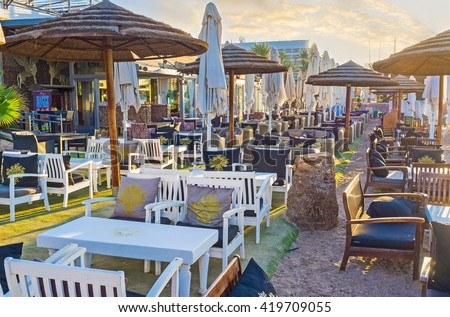 EILAT, ISRAEL - FEBRUARY 24, 2016: The beach restaurant is the best place to relax after the swimming, on February 24 in Eilat.