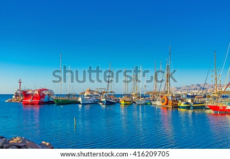 EILAT, ISRAEL - FEBRUARY 24, 2016: The resort boasts various tourist attractions, including yachting, boating, windsurfing, on February 24 in Eilat.