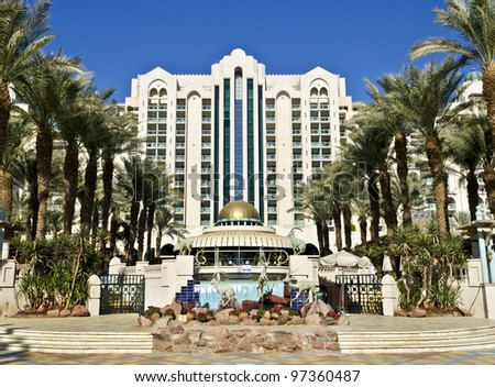 "EILAT, ISRAEL – JANUARY 6, 2012: Facade of luxury five stars hotel ""Herods"" is on the northern beach of Eilat - famous resort and recreational city in the Middle East - stock photo"