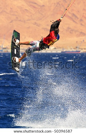 EILAT, ISRAEL - MARCH 31: Unidentified kitesurfer jumps over the water during surfing on Red Sea March 31, 2010 in Eilat, Israel.