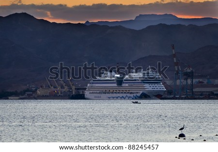 EILAT, ISRAEL – NOVEMBER 6: Luxury cruise AIDA blue ship is moored to port of Eilat on November 6, 2011 in Eilat, Israel. AIDA blue is 252 m long luxury cruise ship, has passenger capacity of 2050, 15 decks, 1096 cabins