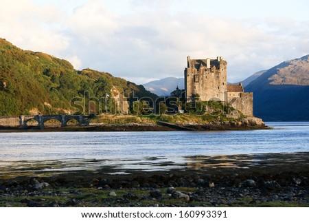 Eilean Donan Castle at twilight in Scotland, UK - stock photo