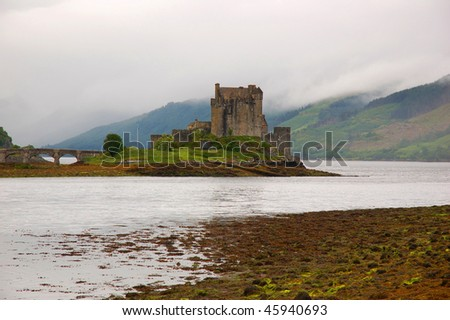 Eilean Donan Castle in a foggy day, Scotland - stock photo