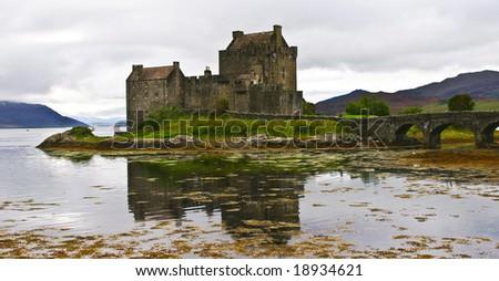 eilean donan castle on a cloudy day - stock photo