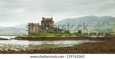 Eilean Donan castle on a cloudy day, Scotland. UK - stock photo