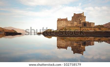 Eilean Donan Castle reflecting on Loch Duich - stock photo