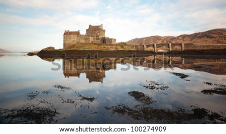 Eilean Donan Castle reflecting on Loch Duich from the isle of Skye. - stock photo