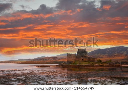 Eilean Donan, Scotland. Scottish castle situated at Loch Duich near Dornie in western part of Scottish Highlands, connected with the mainland by a stone bridge. - stock photo