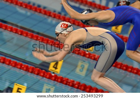 EINDHOVEN, HOLLAND-MARCH 21, 2008: female swimmers on starting blocks during the European Swimming Championship, in Eindhoven. - stock photo