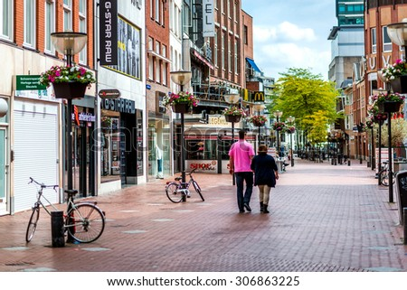 Eindhoven, Netherlands - May 24, 2015: People walking in the Eindhoven main commercial street. It is one of the most famous shopping street in the city with a plenty of stores, bars and clubs  - stock photo