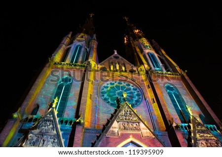 """EINDHOVEN/NETHERLANDS - 14 NOVEMBER-2012: Church with light pattern during lightshow """"Glow 2012"""" in Eindhoven at 14-november-2012 - stock photo"""