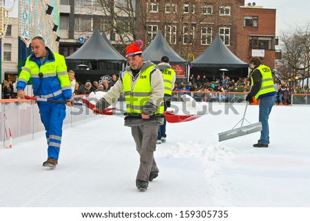 EINDHOVEN, THE NETHERLANDS - JANUARY 2: Workers remove snow on the rink on January 2, 2013 in EIndhoven. the Netherlands.