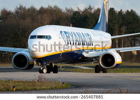 EINDHOVEN, THE NETHERLANDS--13 MAY 2014-- Ryanair Boeing 737 passenger airplane is taxiing to the gate just after landing. - stock photo