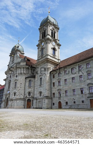 EINSIEDELN, SWITZERLAND - MAY 09, 2016: Front facade of Benedictine Abbey that is dedicated to Our Lady of the Hermits, it is a part of  the monastery complex and is located in the Canton of Schwyz