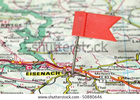 Eisenach - famous city in Germany. Red flag pin on an old map showing travel destination.