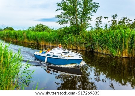 EISENSTADT, AUSTRIA, JUNE 18, 2016: View of a boat on a water channel leading to the neusiedlersee in Austria