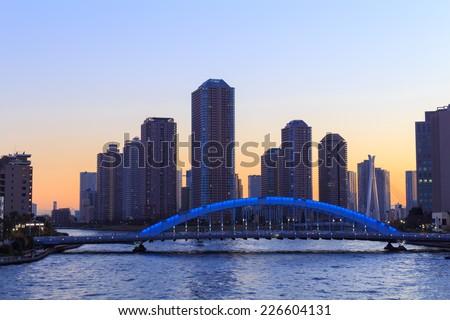 Eitai bridge and Okawabata Rivercity 21 in Tokyo at dusk - stock photo