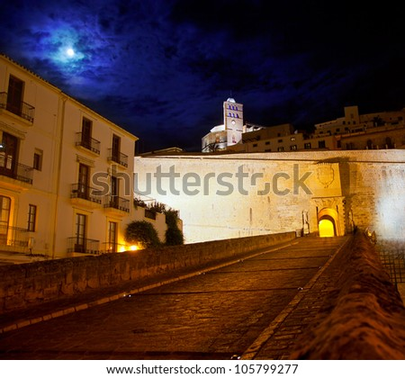 Eivissa Ibiza town with night moon castle entrance and Church