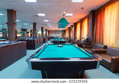 EKATERINBURG, RUSSIA - MAY 19, 2014: Billiard tables in a fashionable night club. Beautiful modern interior