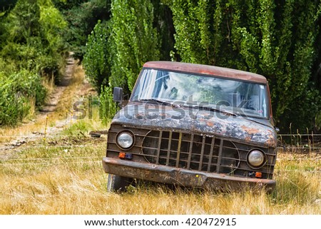 EL BOLSON, ARGENTINA - FEBRUARY 15, 2016: Old car body rusting in the mountains near El Bolson, Patagonia, Argentina - stock photo