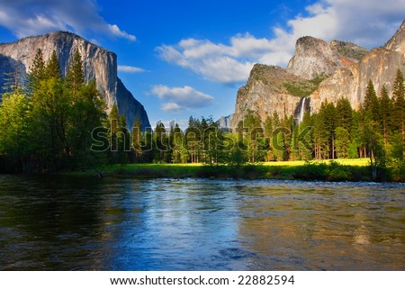 El Capitan and the Cathedral Rocks/ Bridalveil Falls seen from the Merced River.