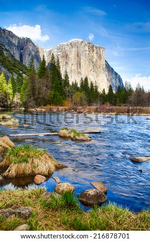 El Capitan towers above the valley floor. View from the Merced River, Yosemite National Park, California. USA - stock photo