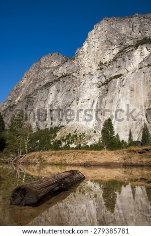 El Capitan with dead tree in watter - stock photo