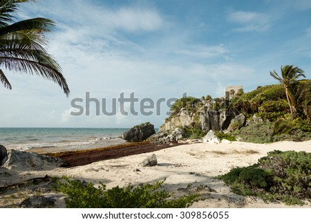El Castillo over the Beach at the Tulum Ruins in  Mexico - stock photo